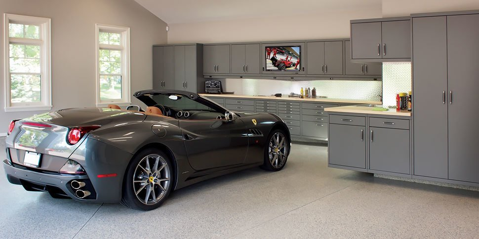 Garage When it comes to kitting out your workspace, look to Garage Living's signature line of modular cabinet systems which can be configured to meet your garage storage needs, space, and budget.  Photo 4 of 10 in 10 Prefab Garage Solutions For Auto Enthusiasts