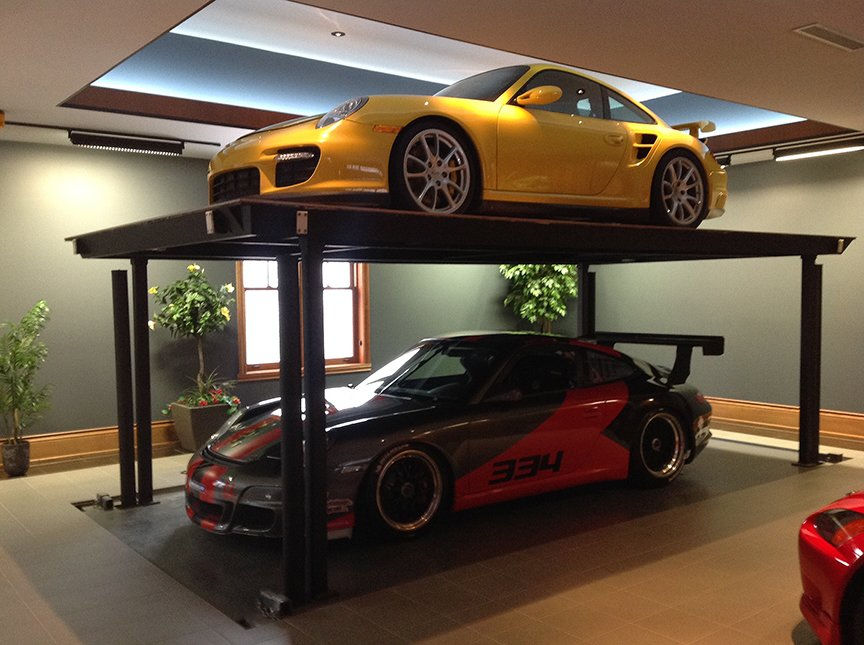 Garage Add an extra Porsche with a custom residential car lift by American Custom Lifts, designers of the first and only American-made single post car lift for storing two vehicles in the parking space of one.  Photo 7 of 10 in 10 Prefab Garage Solutions For Auto Enthusiasts