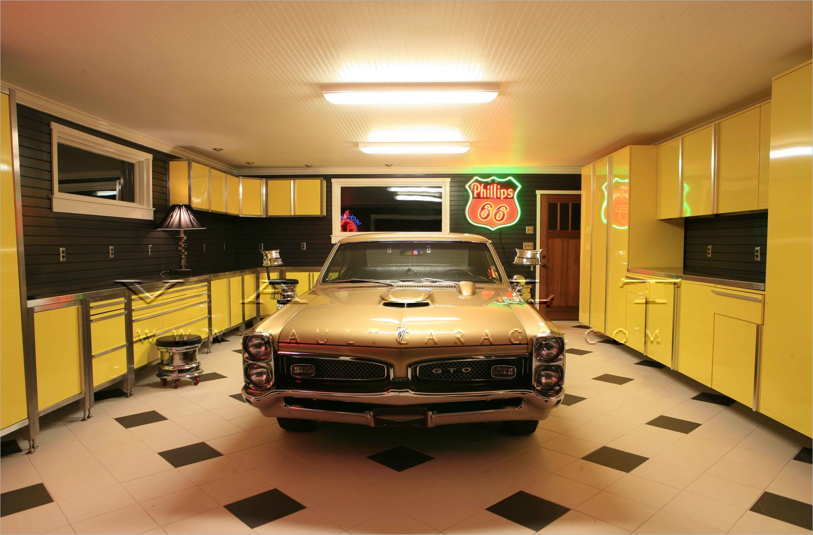 Garage and Attached Garage Room Type From beautiful carriage doors to stainless steel cabinets and antique memorabilia neon signs, Portland-based company Vault designs gorgeous spaces  Photo 8 of 10 in 10 Prefab Garage Solutions For Auto Enthusiasts