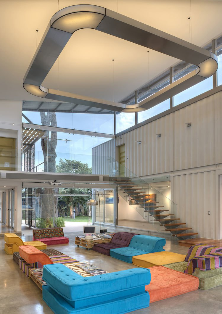 When acclaimed photographer Sergio Pucci wanted to build a home and office on his 6000+ square-foot plot of land, architect Maria Jose Trejos suggested turning shipping containers into a tropical retreat. The result is Casa Incubos, completed in 2013, it's a beautifully designed tropical home and office for Pucci and his wife, a yoga teacher.  Photo 5 of 12 in 10 Beautiful Island-Style Shipping Container Homes