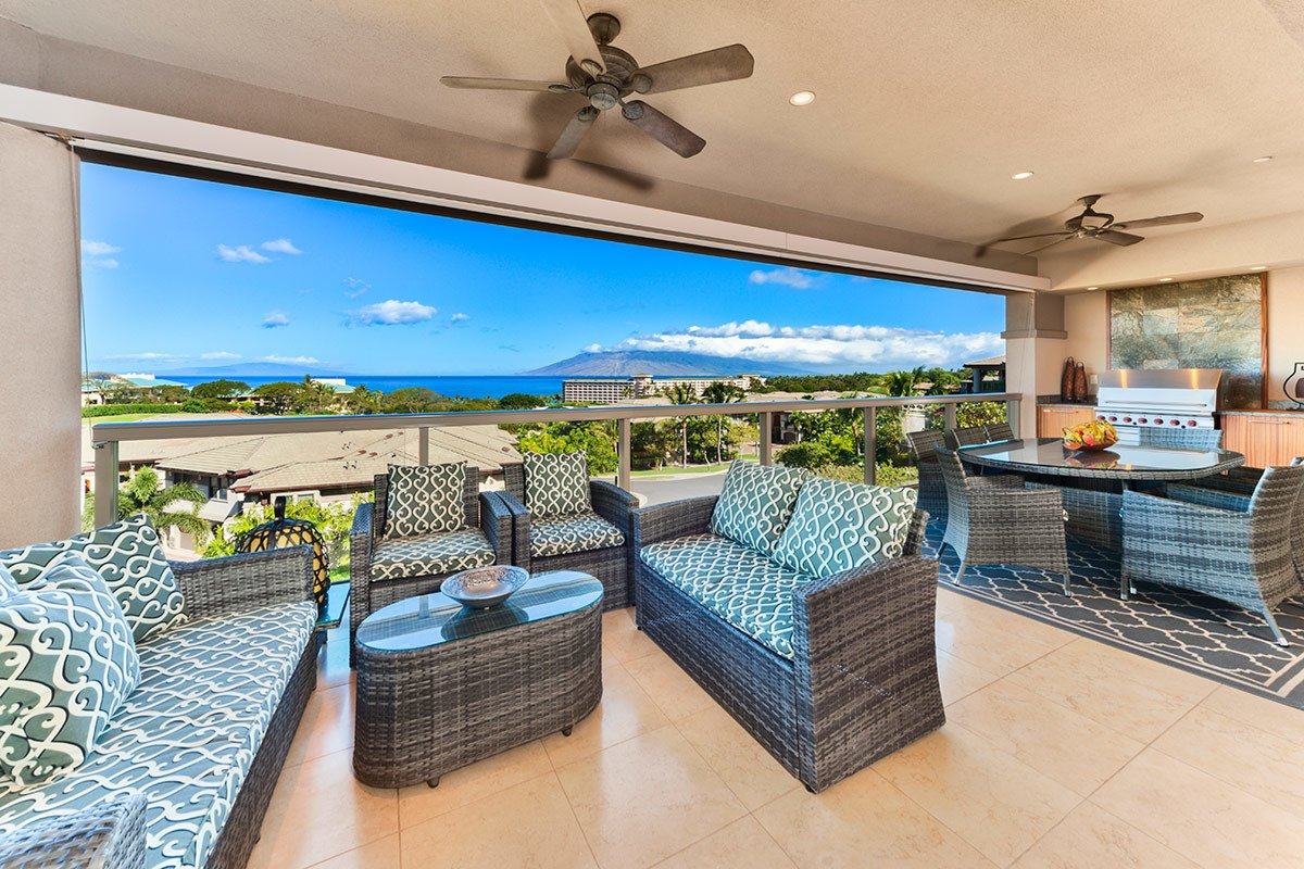 This spectacular three bedroom, three and a half bath, 3,500 square foot, two level home is nestled on the South side of Hoolei, on a very private quiet cul-de-sac bordered by the Wailea Blue Golf Course and a lush green belt slope. As you gaze across green belt, the view of the deep blue Pacific Ocean view is breathtaking. Between the palms, waves gently break on one of the best beaches in the world  Photo 4 of 10 in 10 Dream Modern Home Rentals In Hawaii