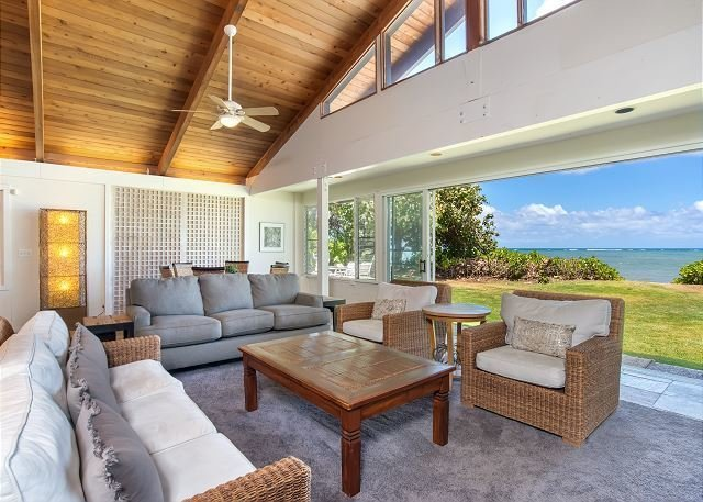 Drive down the driveway, past an enormous banyan tree, to this large home. This classic Hawaiian home, with its original lava rock wall entrance, is the main house on one of east Oahu's larger ocean front properties. It has been remodeled, while maintaining its original Hawaiian charm.  Photo 8 of 10 in 10 Dream Modern Home Rentals In Hawaii