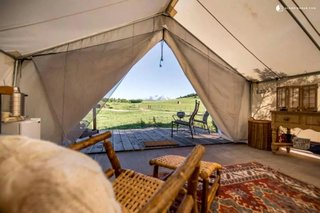 This unique safari tent can be found near White River National Forest, Colorado, and is perfect for a glamping getaway. The tent features a beautiful California king four poster bed that guarantees a peaceful sleep. There is also a deck where guests can enjoy soaking in the beautiful views.
