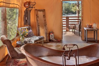 At this sprawling resort just east of Missoula, honeymooning couples can choose between six glamping tents, each fitted with a king bed, jetted tubs/showers, and luxury resort amenities. Honeymooners will definitely want to book the Tango Point tent. In addition to its prime location along the banks of the scenic Blackfoot River, the suite comes with heated slate floors, a dining pavilion with fireplace and lounge, plus your very own camping butler.