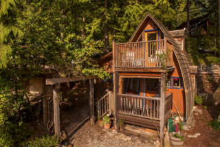 """Airbnb's fourth """"most-wishlisted"""" property in Canada according to the owners, this beautiful loft cabin has incredible views of the Sechelt Inlet and gets all the afternoon sun. The beach is a three-minute walk downhill, and the quiet community sits at the end of the road."""