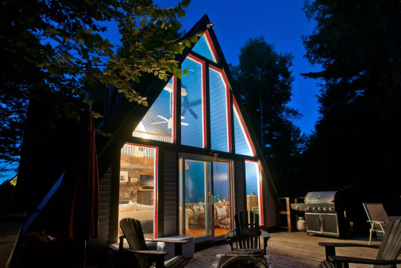 Exterior, Wood Siding Material, Cabin Building Type, Glass Siding Material, and A-Frame RoofLine A cozy pet friendly A-frame nestled in the Jay Range with view of Whiteface Mountain. The home features a living room, fireplace, loft bedroom and fully equipped kitchen. With endless activities to choose from, we are located just 10 minutes from Whiteface Mountain and 20 minutes from Lake Placid.  Photo 11 of 12 in 11 A-Frame Cabins For A-Grade Getaways