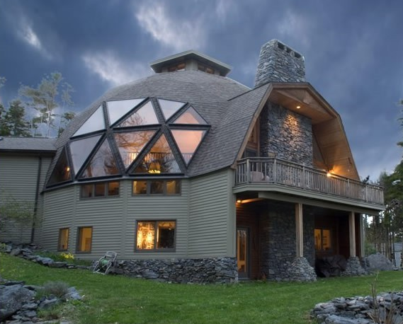 geodesic home with brick chimney