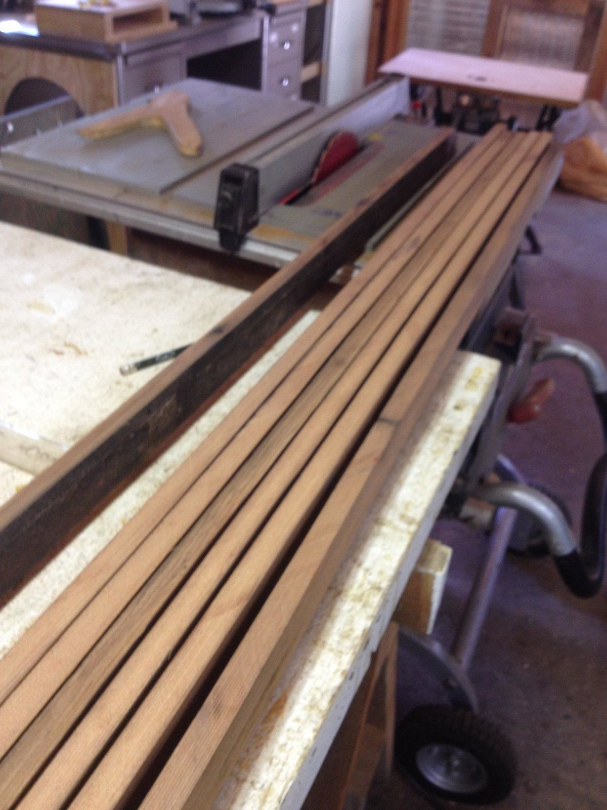 Once clean, planks were re-sawn on a table saw to get about 2 inch wide strips, then re-sawn again so that they were about a quarter inch thick.  Photo 5 of 26 in Crafting a Hollow Wood Surfboard from Old-Growth Redwood