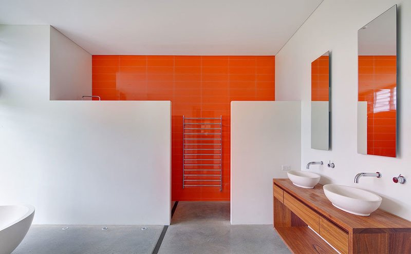 A bold color simply on one wall makes the difference in brightening this otherwise blank space.  Photo 1 of 11 in These 10 Designers Are Experts at Creating Colorful Bathrooms That Pop