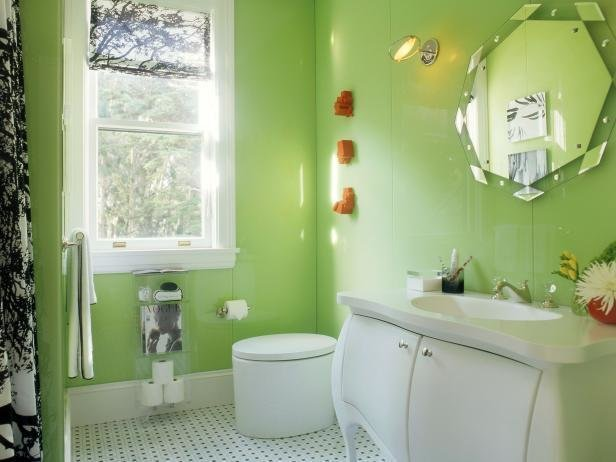 Apple Green walls and an engaging floor pattern sparkle in this design by Steven Miller.  Photo 10 of 11 in These 10 Designers Are Experts at Creating Colorful Bathrooms That Pop