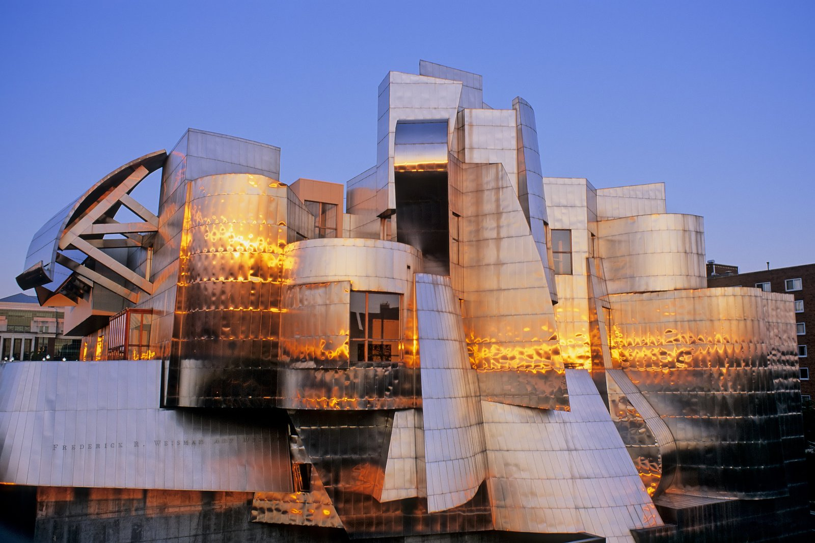 """Exterior and Metal Siding Material Representing Frank Gehry's first museum built from the ground-up, the Weisman Art Museum is located on the banks of the Mississippi River on the University of Minnesota's Twin Cities campus. Affectionately known as the """"Baby Bilbao,"""" a reference to the later Guggenheim's iconic museum in Spain, the Weisman's organic curves of stainless steel were designed without the aid of computer software, predating a process Gehry would later innovate through his use of CATIA modeling software.  Photo 4 of 14 in 13 Iconic Buildings Designed by Frank Gehry"""
