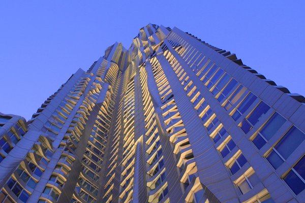 Exterior an 899-unit residential apartment building that also includes a pre-K to grade 8 public school, an ambulatory care center, retail space, and parking on the lower levels. The 1,040,904-square-foot, 76-story building is 870 feet tall and was at the time of its completion the tallest residential building in North America. The building, which features a rippling, undulating stainless steel facade, has become an iconic landmark that has captured both local and global attention and won critical acclaim.  Photo 11 of 14 in 13 Iconic Buildings Designed by Frank Gehry