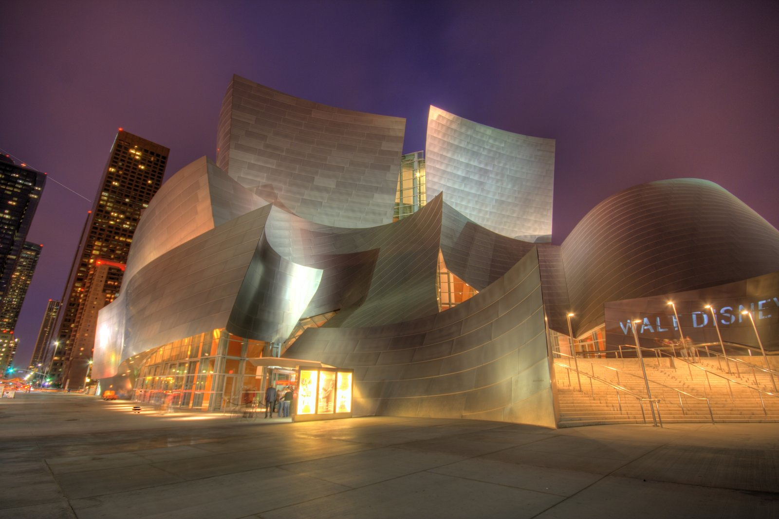 Exterior Walt Disney Concert Hall has received wide acclaim for its excellent acoustics and distinctive architecture. In the decade since its opening, the hall's sweeping, metallic surfaces have become associated with Frank Gehry's signature style.  Photo 3 of 14 in 13 Iconic Buildings Designed by Frank Gehry