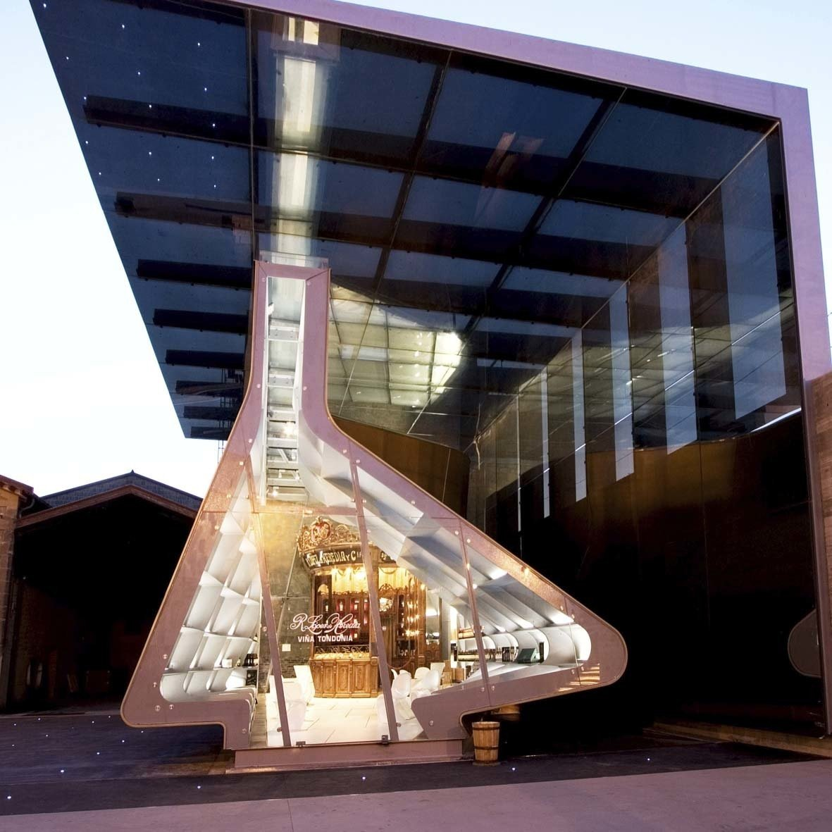 """Exterior López de Heredia commissioned Hadid to crate a new extension to their existing bodegas, which now houses the old stand and a shop, entertainment and exhibition area, citing  Photo 4 of 18 in """"Queen of the Curve"""": 18 Influential Works by Zaha Hadid"""