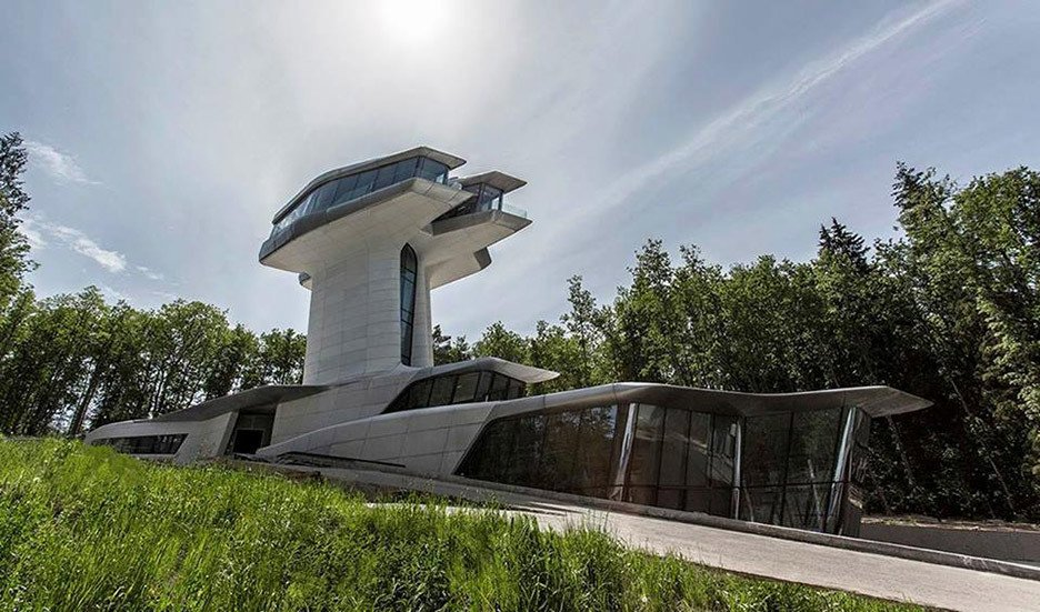 """Capital Hill Residence is a villa in Barvikha Forest close to Moscow, which was designed for Russian property developer Vladislav Doronin. Completed in 2011, it is the only private house that Hadid built during her lifetime. Tagged: Exterior.  Photo 11 of 18 in """"Queen of the Curve"""": 18 Influential Works by Zaha Hadid"""