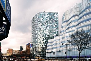 """Jean Nouvel called this 23-story residential tower a """"vision machine."""" Each windowpane rests inside a series of """"mega-panels"""" that are tilted at different angles, offering slightly different degrees of transparency."""