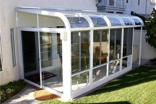 Themanacooler.com is a good resource to start your search for an optimum sunroom solution, with some advice on the best positioning for your new sunroom, and some technical suggestions in what to look for in terms of glass and frames.