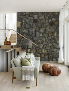 The exterior field stone wraps into the interior here, further blurring the line between indoors and out.