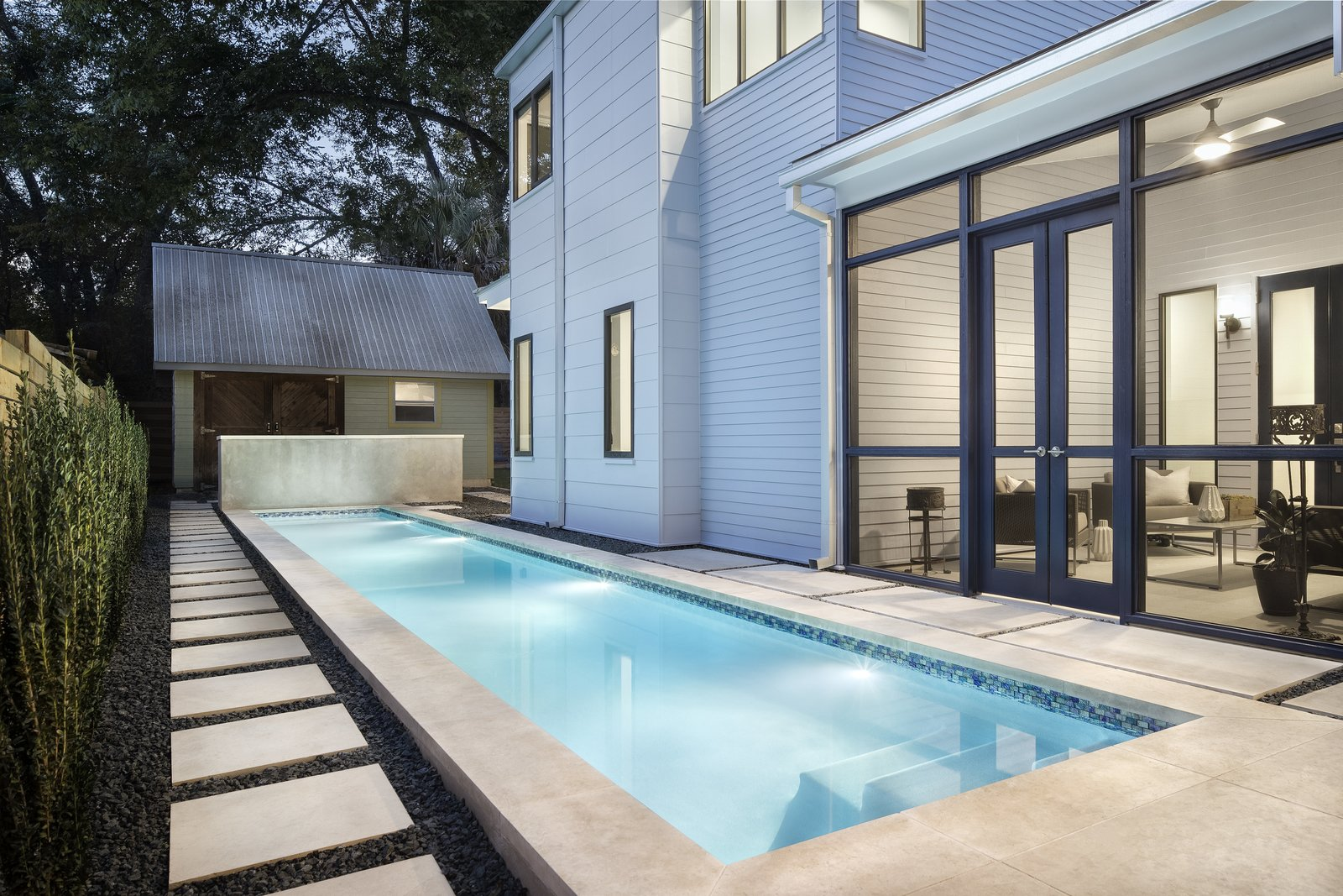 A compact lap pool tucked on the south side of the house is bounded by both the master bedroom and central screen porch.  www.clarkrichardson.com  Central Austin Residence by Clark Richardson Architects