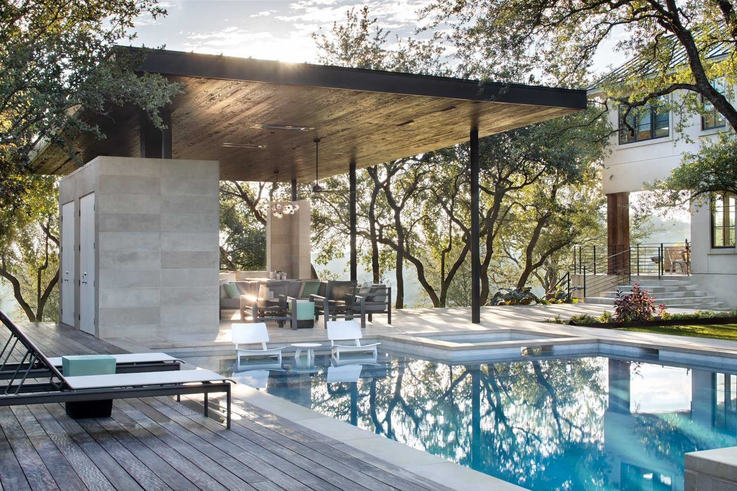 Outdoor, Large, Large, Hanging, Trees, and Back Yard The view from Longchamp Outdoor Living's ipe pool deck. Clark Richardson Architects designed the multi-use space to be perfect all year long.  Best Outdoor Photos from Longchamp Outdoor Living