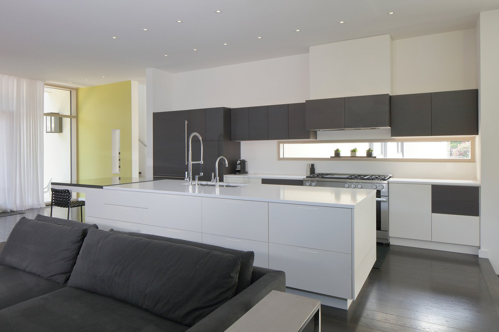 Kitchen, Engineered Quartz Counter, White Cabinet, Wood Cabinet, Dark Hardwood Floor, Ceiling Lighting, Range, Refrigerator, and Undermount Sink Kitchen  The Hartley Pavliska House