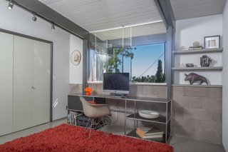 The airy yet enclosed home office provides a quiet setting to get work done.