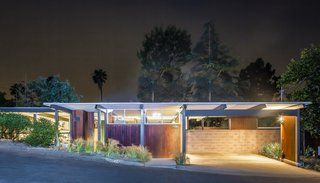 The Richard and Helen Arens House glowing gorgeously at night.