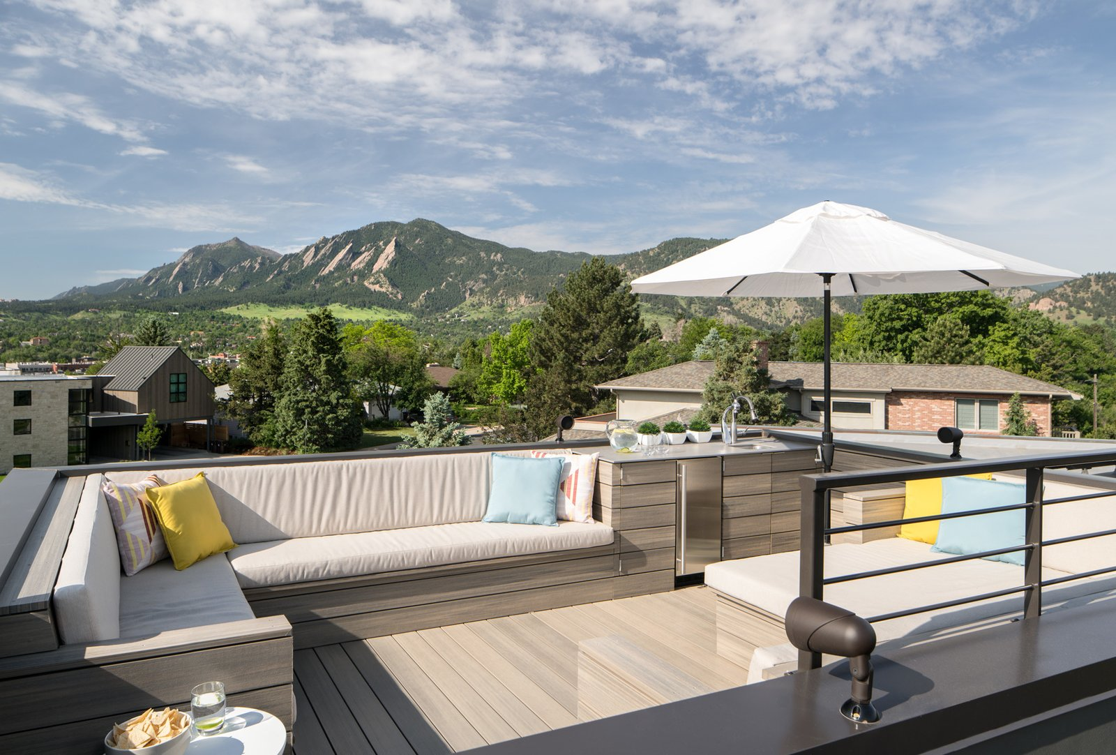 A rooftop deck provides 360-degree views of the Boulder Flatirons and the entire front range.  Sunset House by HMHAI