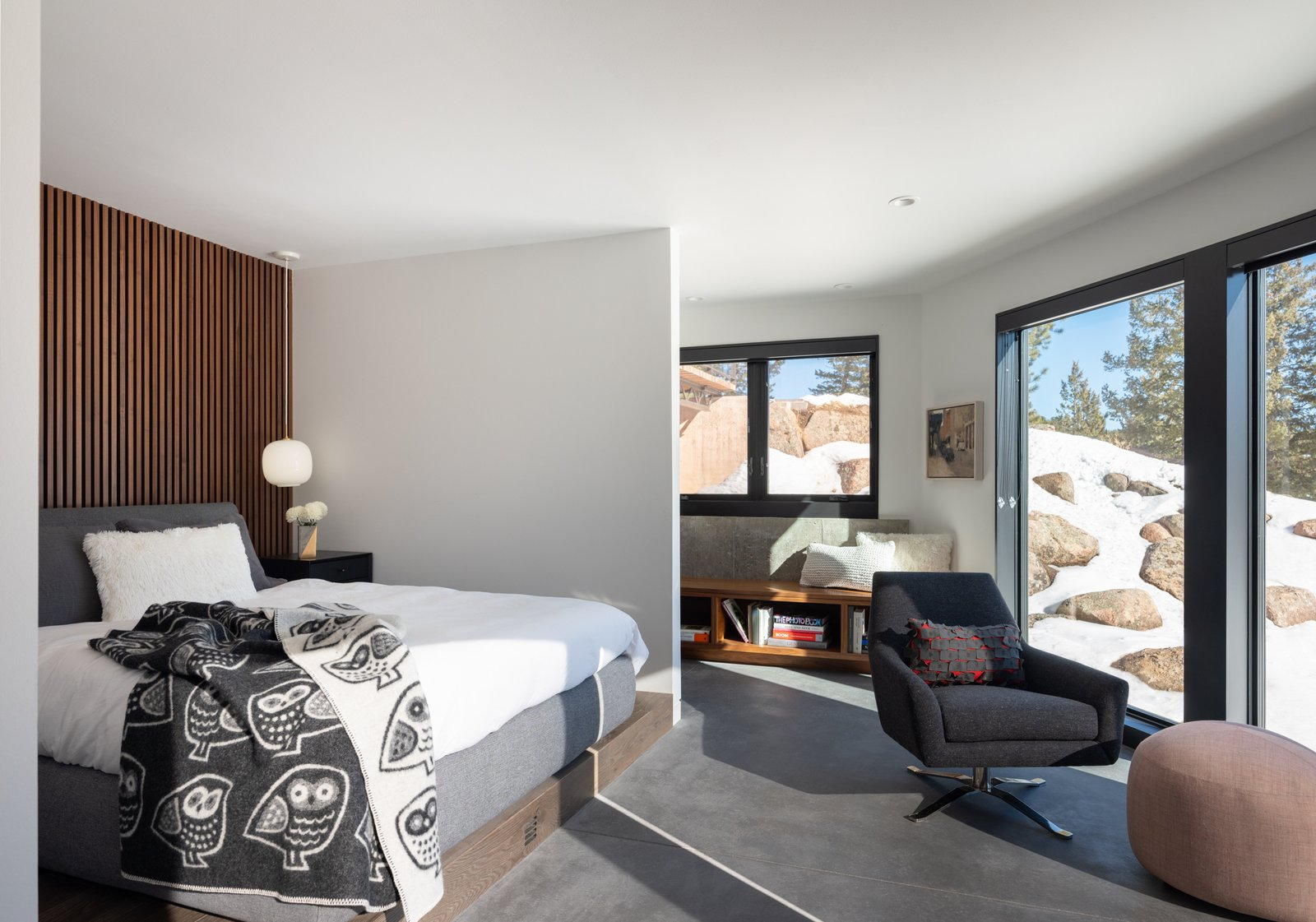 Bedroom, Concrete Floor, Pendant Lighting, Bed, Storage, Chair, Recessed Lighting, and Bench A cozy and comfortable guest bedroom is key to making sure guests feel welcome in your home.  Photos from Modern Cabin