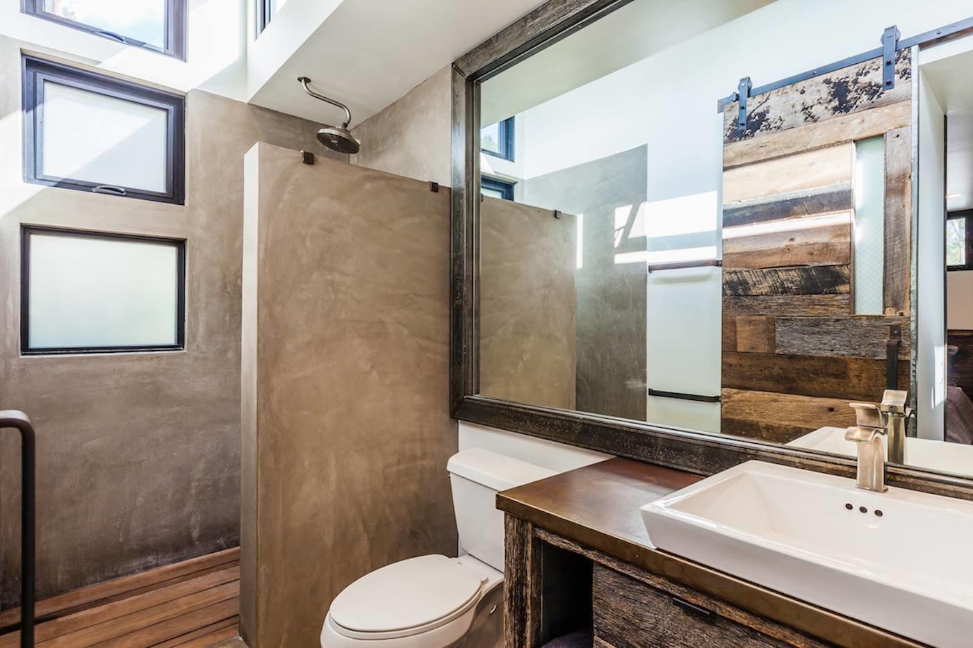 Bath Room, Ceiling Lighting, Metal Counter, Open Shower, Light Hardwood Floor, and Concrete Wall Gorgeous Master Bath  Reclaimed Malibu Modern Beach Retreat