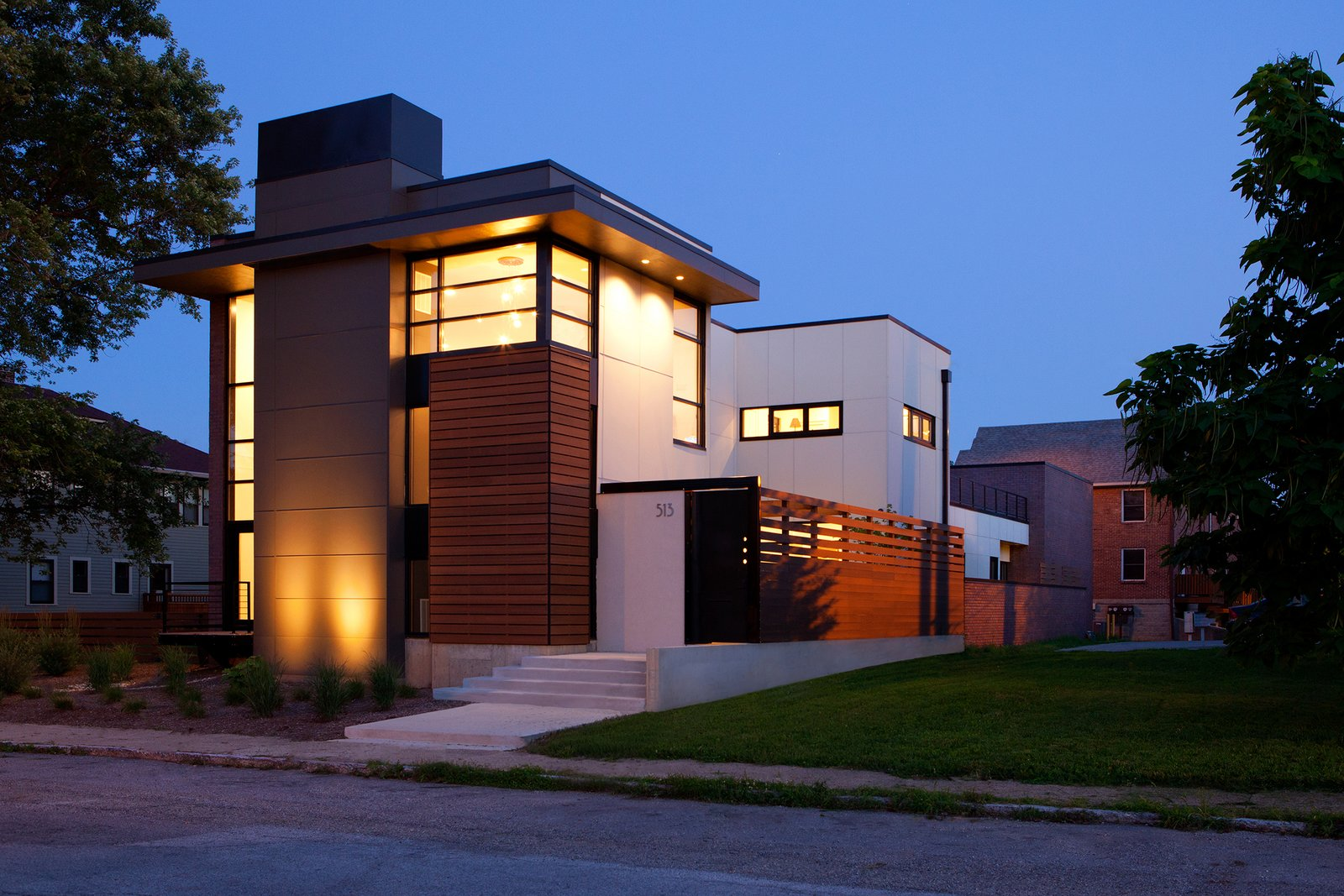 Exterior, House Building Type, Wood Siding Material, and Flat RoofLine The design provides a layer of privacy for the homeowners, while the solid massing peels away to large expanses of glazing, framing intended view sheds both inward and outward. Along with its verticality, the home pulls key horizontal elements from the established neighborhood rhythm, specifically the eaves and elevated floor lines.  City Cottage by ONE 10 STUDIO Architects