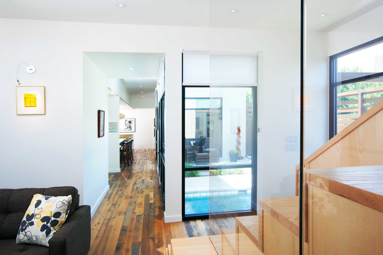 Plunge Pools, Tubs, Shower, Medium Hardwood Floor, Staircase, Glass Railing, and Wood Tread A Zen-like plunge pool situates itself at the corner of the court, visible from many areas of the house and welcomes guests along their entry journey.  City Cottage by ONE 10 STUDIO Architects