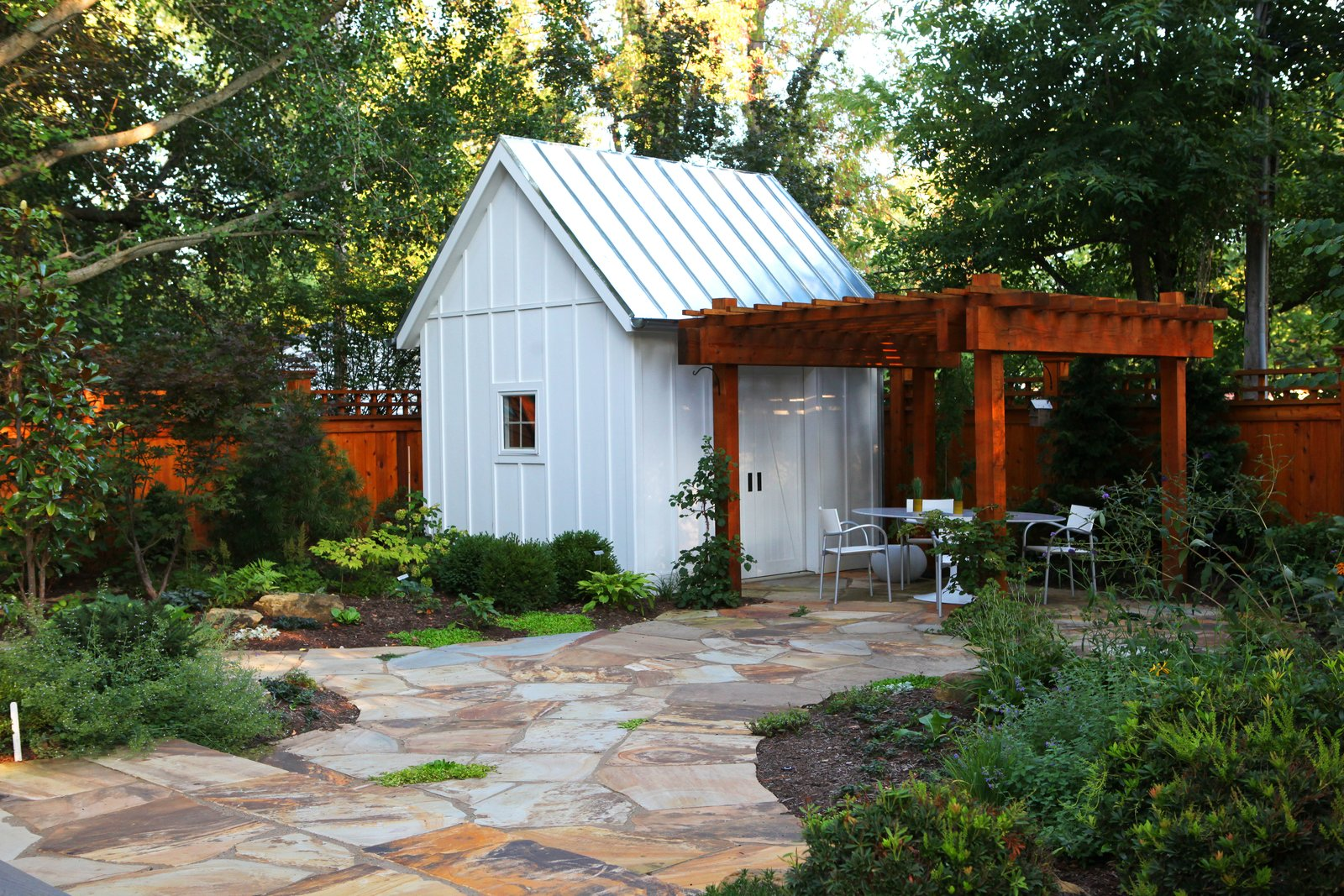 Shed & Studio and Storage Space Room Type The Owner, a master gardener, desired a direct visual connection to the backyard, gardens, garden shed and pergola as an integral component of the design.  Urban Farmhouse