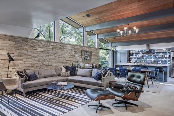 The new open-plan living/dining/kitchen space benefits from the raised ceiling height and the addition of the clerestory windows on the south, west and north sides.
