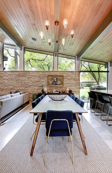 The dining space. The Joules midcentury modern chandelier was ordered from Etsy.