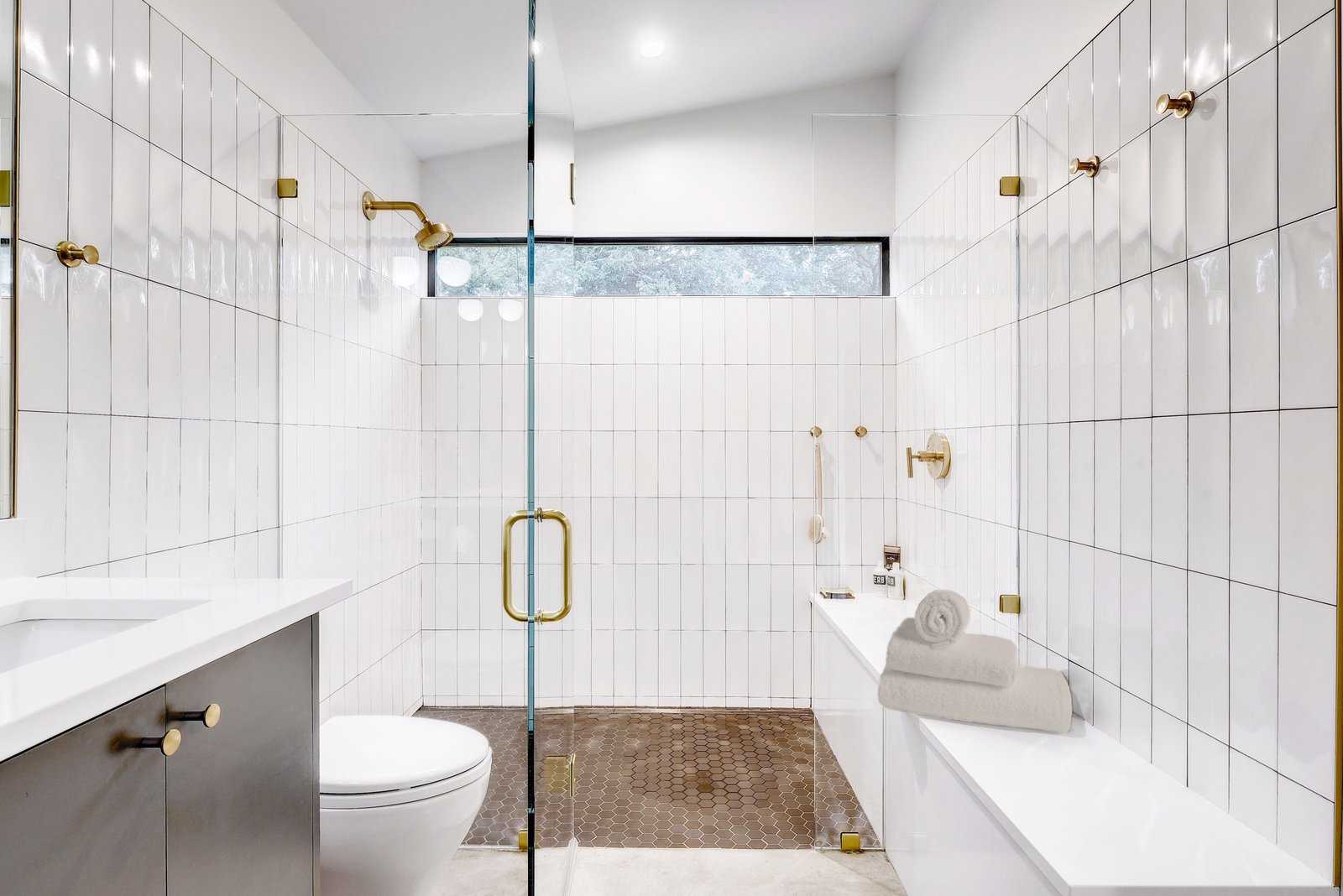 Bath Room, Subway Tile Wall, Drop In Sink, Enclosed Shower, Cement Tile Floor, Recessed Lighting, Ceiling Lighting, Full Shower, Concrete Floor, and One Piece Toilet Re-Open House by Matt Fajkus Architecture | Photo by Twist Tours  Re-Open House by Matt Fajkus Architecture