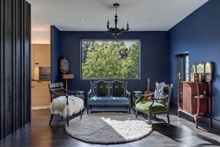 The sitting area is finished with dark surfaces and heavy, antique furnishings.