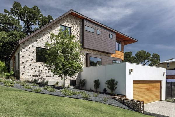 The design of the remodel negotiates a 12-foot drop from the front of the lot to the back with a modified roof form that allows for three stories.