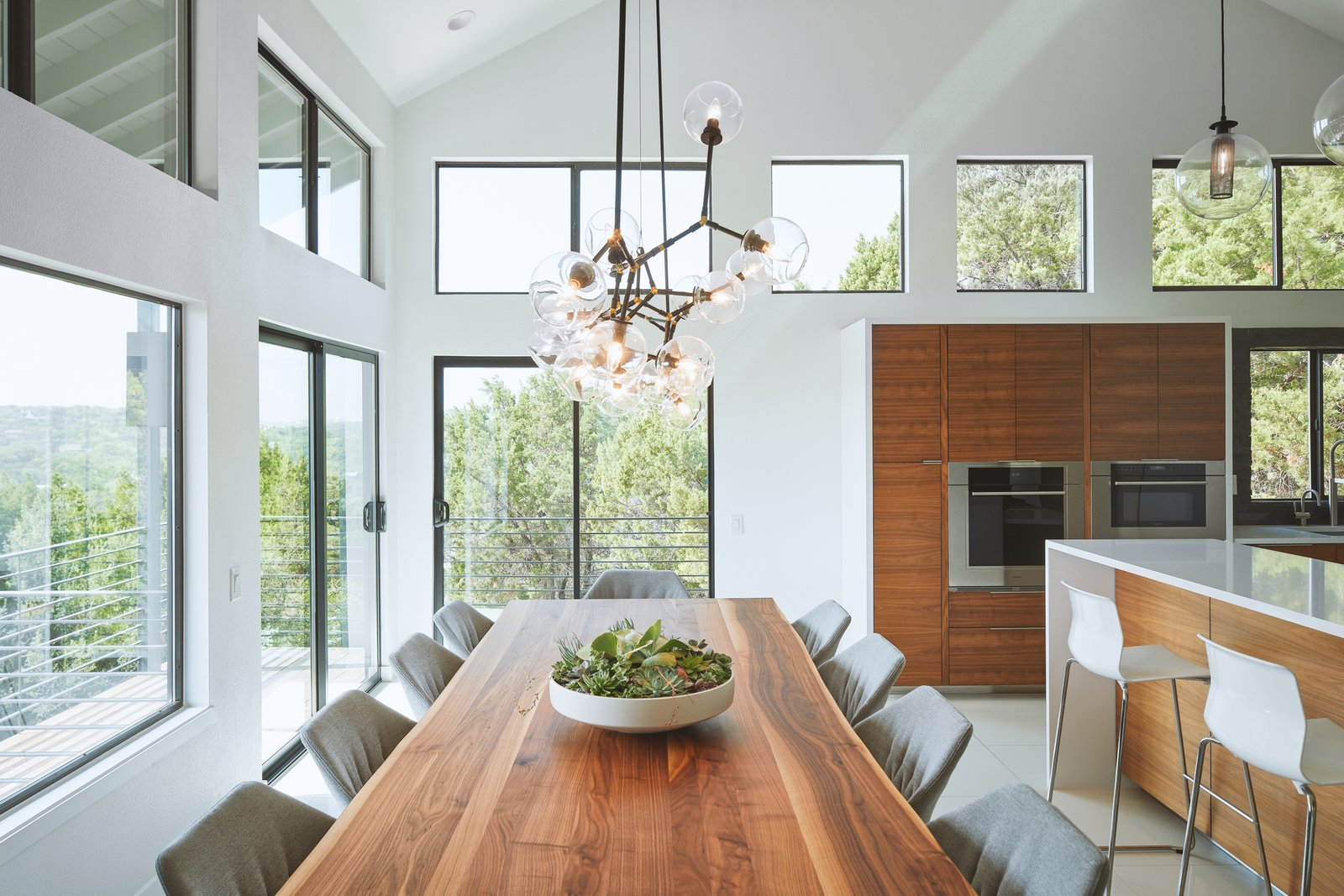 Dining Room, Table, Chair, Stools, Pendant Lighting, Recessed Lighting, and Ceiling Lighting Via Media Residence by Matt Fajkus Architecture | Photo by Leonid Furmansky  Via Media Residence by Matt Fajkus Architecture