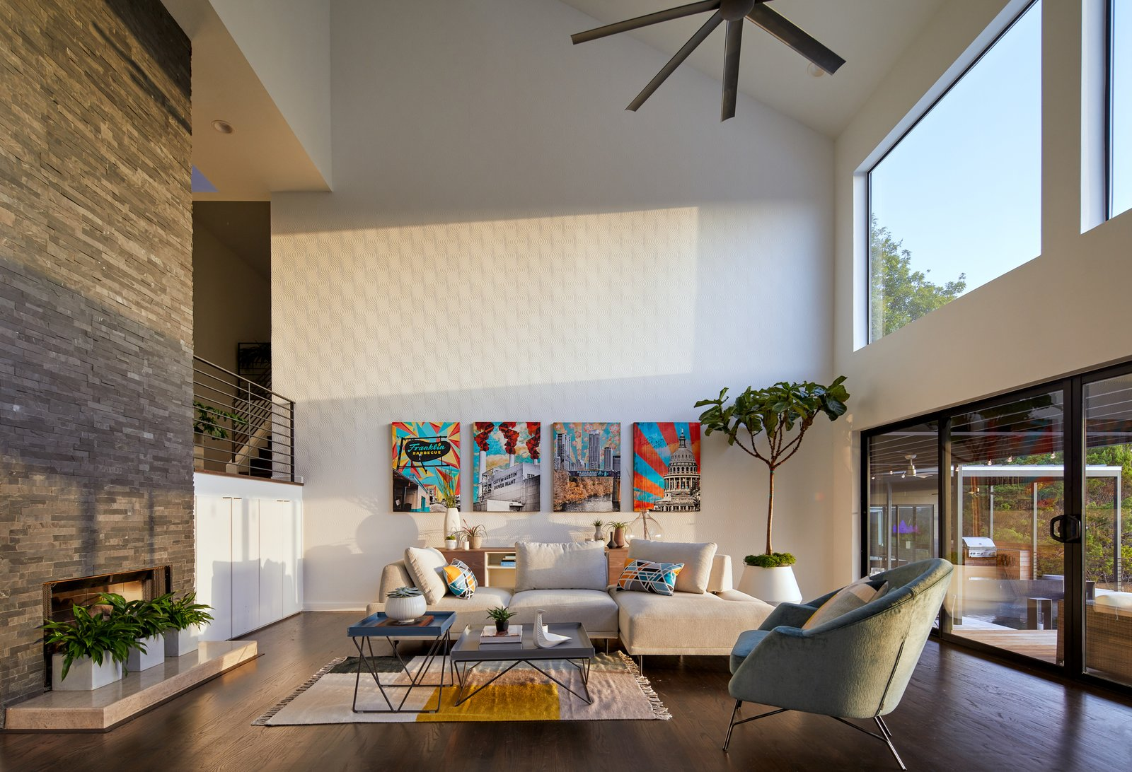 Living Room, Sofa, Sectional, Ceiling Lighting, Recessed Lighting, Coffee Tables, Console Tables, Dark Hardwood Floor, and Standard Layout Fireplace Via Media Residence by Matt Fajkus Architecture | Photo by Leonid Furmansky  Via Media Residence by Matt Fajkus Architecture