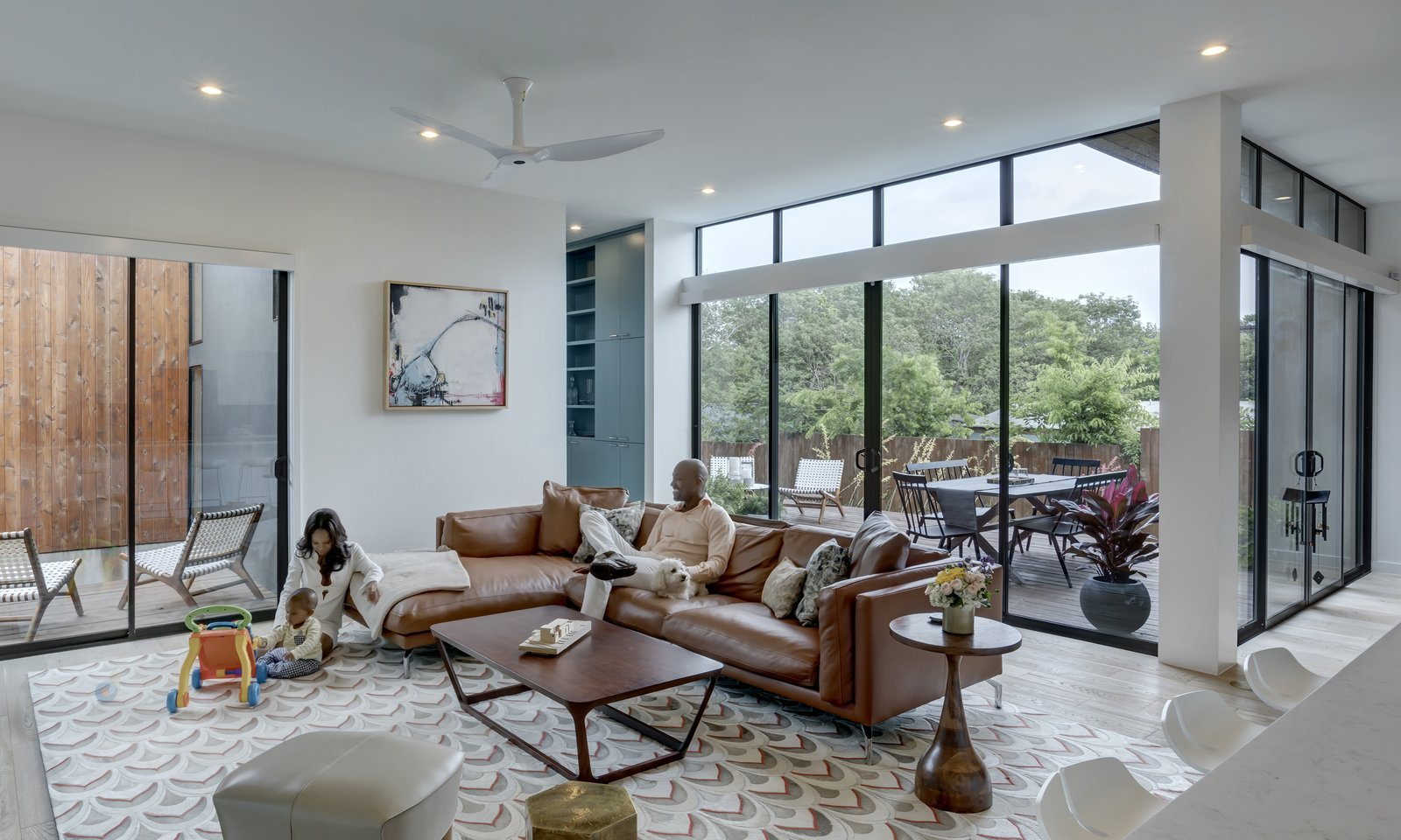 Living, Storage, Sectional, End Tables, Coffee Tables, Rug, Sofa, Shelves, Light Hardwood, Recessed, and Chair Add/Subtract House by Matt Fajkus Architecture   Photo by Charles Davis Smith  Living Sectional Storage Photos from Add/Subtract House