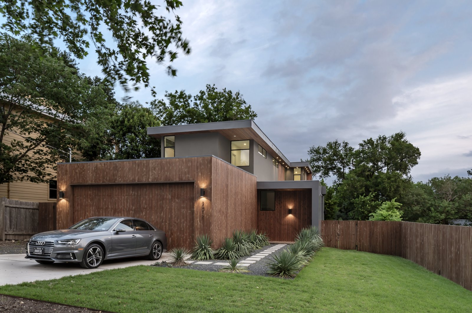Exterior, Metal Roof Material, Wood Siding Material, Metal Siding Material, House Building Type, Flat RoofLine, and Stucco Siding Material Add/Subtract House by Matt Fajkus Architecture | Photo by Charles Davis Smith  Photos from Add/Subtract House