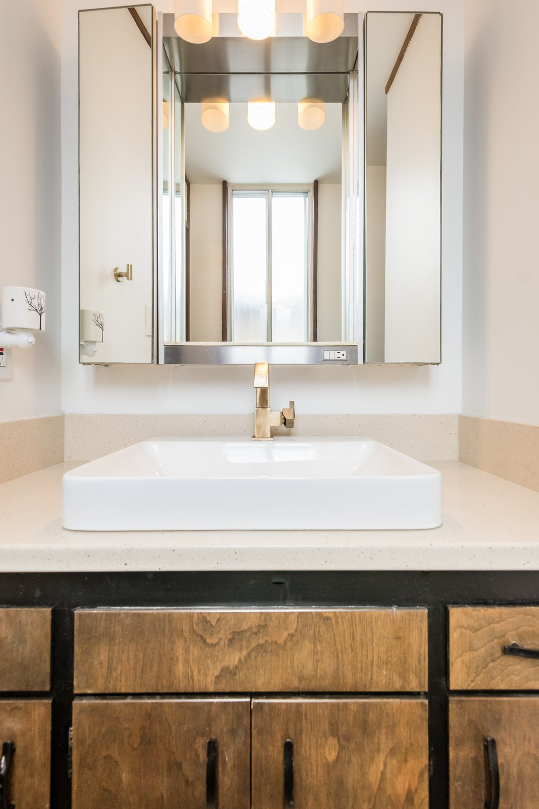 Slightly updated bath with champagne bronze hardware through out the home  Ron Molen Revival