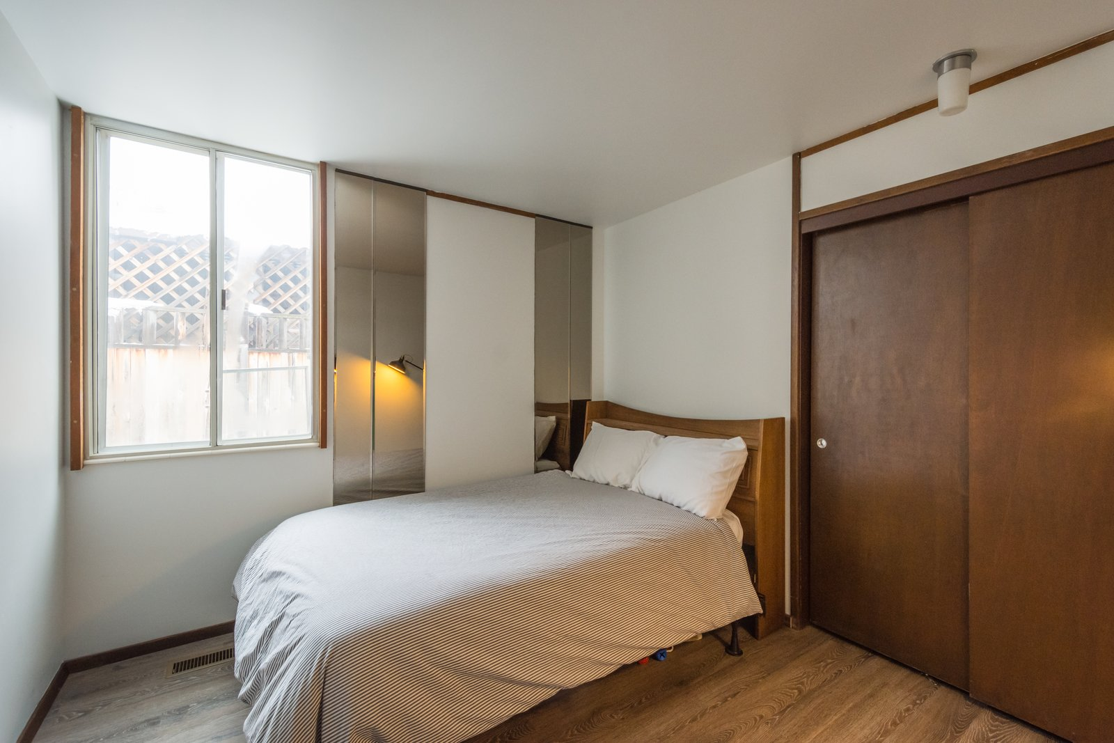 Guest Bedroom with original mirrors  Ron Molen Revival