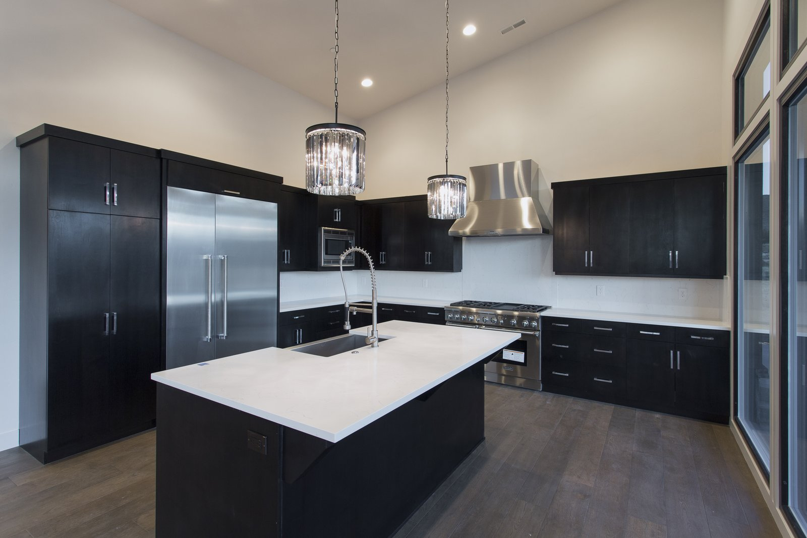 Dark brown cabinets accented with white cabinets  Palisades 14