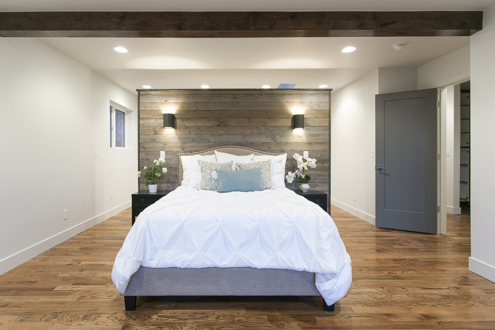 The master bedroom has been laid out so this partition wall doubles as a headboard and a wall for you master closet. Easily accessble  no matter what side of the bed you wake up on.  King of the Wasatch