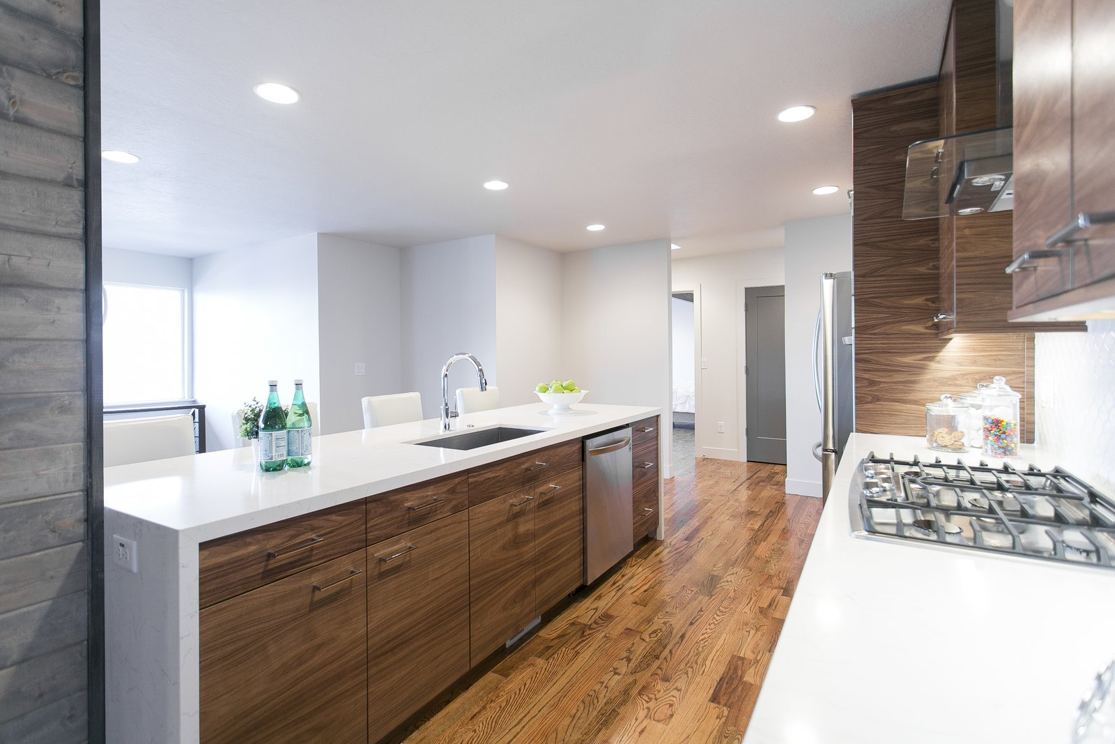 The kitchen island is complete with quiet close hinges and a waterfall counter top.  King of the Wasatch