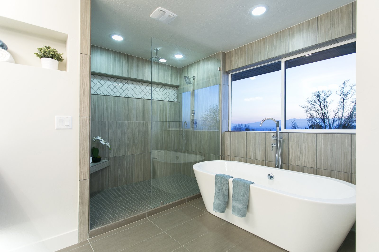 The master bathroom has been fully reworked to capitalize on the sweeping views that can be seen not just from the master bedroom but out the window perched directly above the soaking tub.  King of the Wasatch