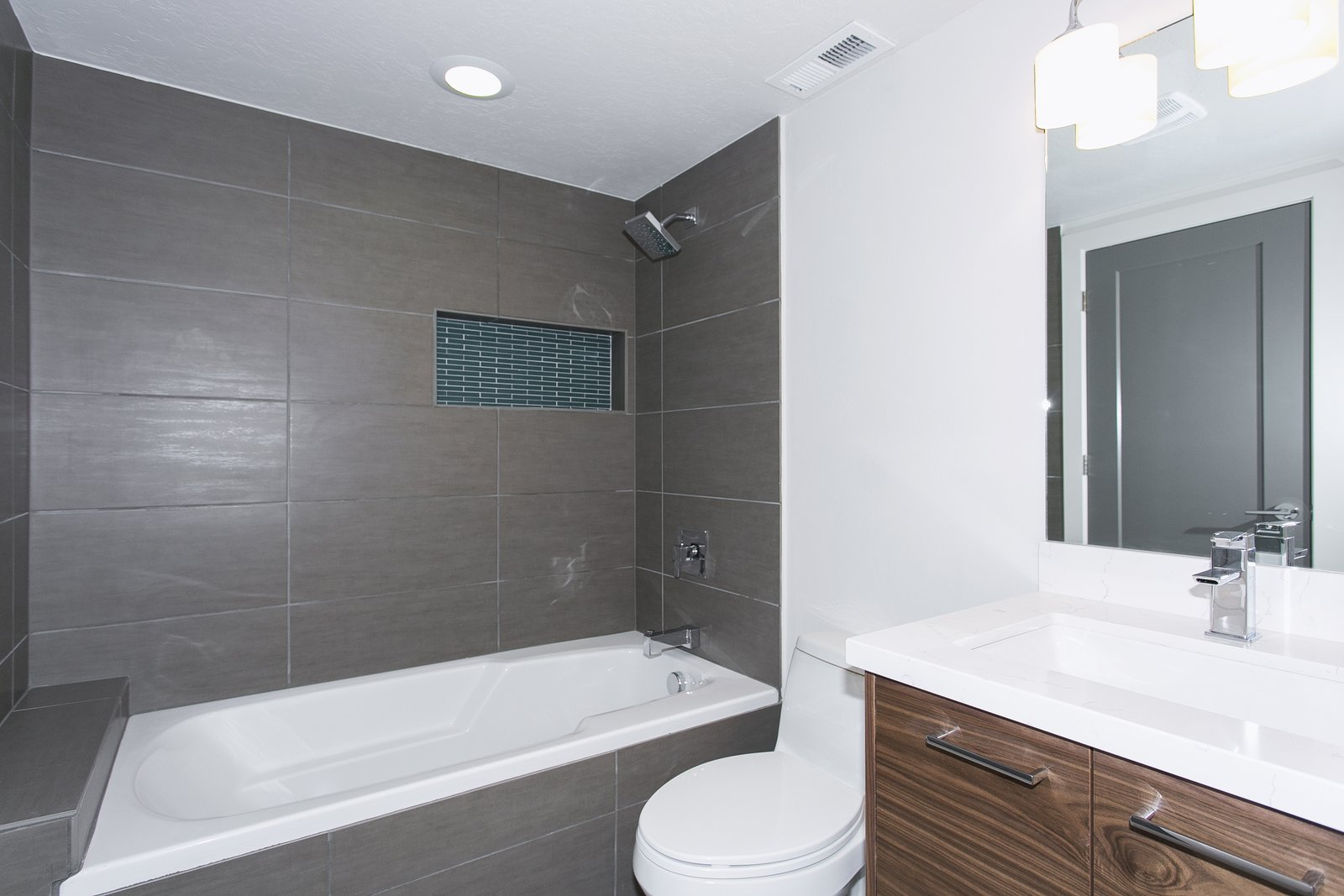 All baths have been updated with new horizontal straight lay tile with convenient storage nooks.  King of the Wasatch