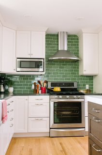 "Fireclay Tile in a classic subway pattern goes beyond the standard 18"" H backsplash raising the ceiling visually."